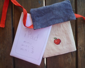 Cheerful and cheeky mini iPad cover/sleeve, cross stitched with a juicy red apple, made from 100% linen.
