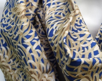 Infinity scarf #42--buy 3, pay shipping for 1 (save 12.20)--use coupon code shipfee610 at checkout. Gold and blue