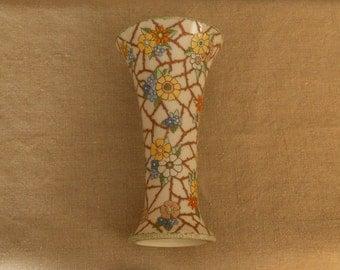 beautiful, vintage vase with embossed flowers