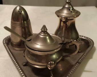 Silver plated salt and pepper shakers with mustard/sugar bowl and tray