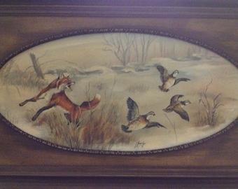 Fox leaping at phesant