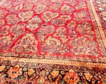 Stunning oversize Antique Persian Sarouk Rug.
