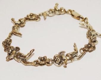 """Vintage Sterling Angels With Flower Links 7"""" Long Bracelet."""