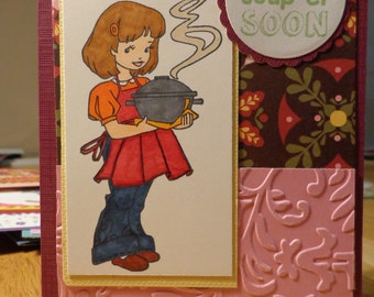 Girl holding soup tureen card