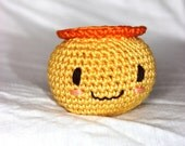 Smiley stress ball / baby rattle made from organic cotton