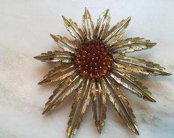 Vintage Sarah Coventry star burst gold tone brooch