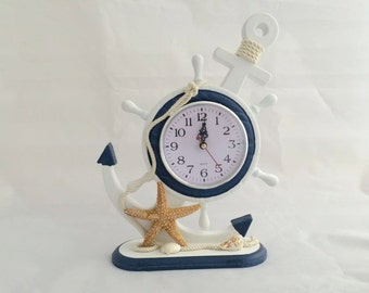 collectiable clock clock! wall clock pendulum clock! Beatiful and useful! Seastar shell  lovely! collectiable blue and white