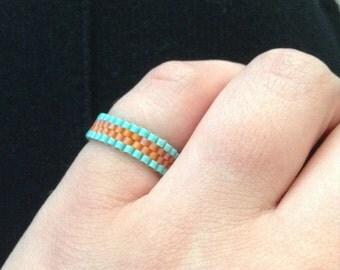 Aqua-bordered Tangerine Ring