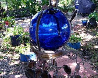Mermaid windchime with 5 inch blue glass float and lots of circles cut from stainless steel