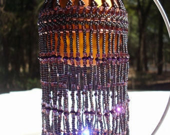 Hand beaded ornament in Purple and Copper