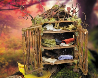 "Fairy Furniture, ""Forest Gnome's Armoire"", an original piece from our book ""Fairy House"" made of twigs, moss, pods, 6"" x 8"""