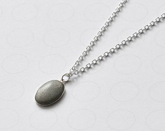 minimalist necklace with concrete pendant and sterling silver