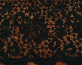 Wide black scalloped lace.