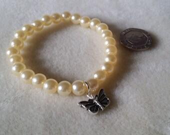 pearl effect butterfly charm bracelet