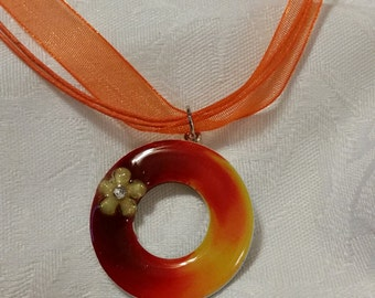 Red orange yellow washer pendant with gemmed flower