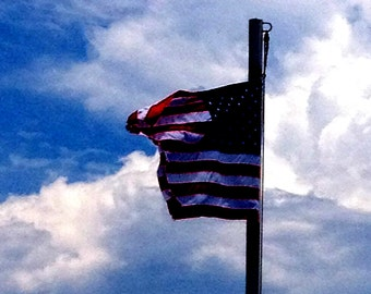 American Flag Waves high amongst the clouds