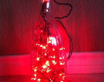 Repurpose wine bottle lights .