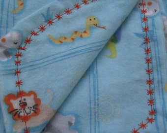Rockaby Safari Park flannel baby blanket with matching burp cloth