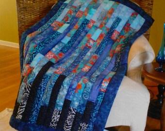 Boho style modern blue/red/black batik lap quilt