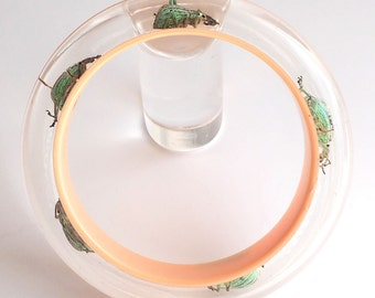 Cream lucite bangle with real iridescent beetles