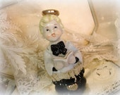vintage choir boy figurine . adorable ceramic figurine with lace hand painted gold halo choir robe with song book