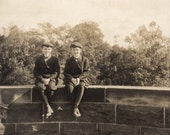 vintage photo 1917 Twin Boys Short Pants Caps Sit on Wall