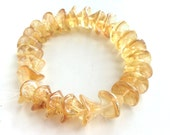 Jonquil Celsian Flower Beads Czech Pressed Glass Trumpet Citrine color