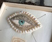 Gorgeous handmade white big eye brooch with pearls