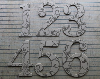 2 1/2 inch tall Numbers 1-12 with white silver glitter swirls cardstock over chipboard diecuts great for wedding table numbers