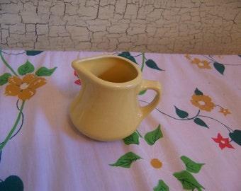 adorable yellow creamer pitcher