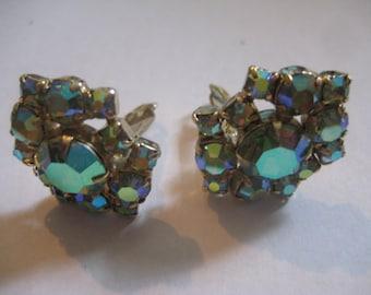 Vintage Clipback Rhinestone Earrings with Peridot Aurora Borealis Finish in Goldtone