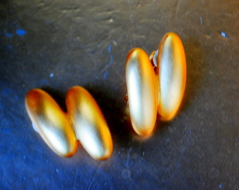 Mod style vintage 80s bold gold tone metal clip on earrings.  Authentic Givenchy.  Paris- New York.