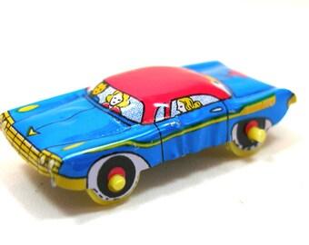 60s Tin toy car,1960s Japanese sedan, blue, pink & yellow.
