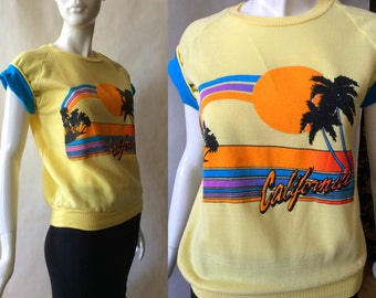Vintage souvenir California tee, yellow with fold up blue lined sleeves, sunset and palm tree print in neon colors, 1980's, women's medium