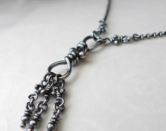 Sterling Silver Necklace. Rustic Oxidized Knot Pendant with dangling little knots and beads. Rollo chain -Nodo with Knots-