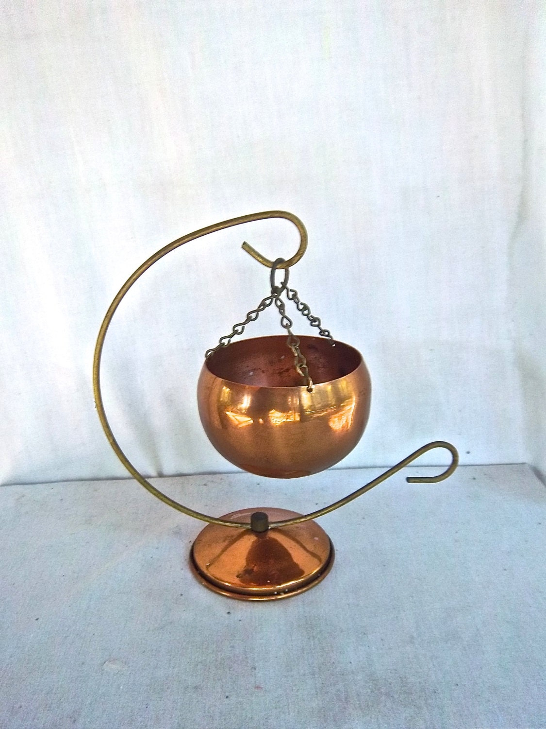 vintage hanging copper pot planter display with brass wire