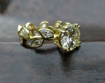 Leaf engagement ring design. White sapphire engagement ring.  14k yellow gold leaf ring. Marquis shaped white sapphires.