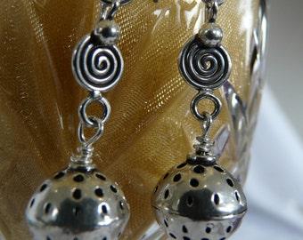 Long dangly silver earrings