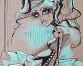 Aqua and Mint Tattooed Pinup Girl Wearing a Corset and Tutu