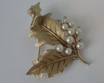 Gold tone Leaf Crown Trifari  Brooch with faux pearls and tiny rhinestones.