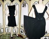 1950's Black Chiffon Cocktail Dress with Sain Bows and Back Tail Sash. Medium.