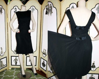 1950's Black Chiffon Cocktail Dress with Sain Bows and Back Tail Sash. Medium.