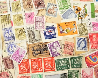 55 salvaged vintage postal stamps around the world for your altered art collage scrapbook project