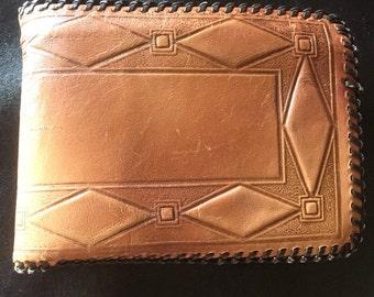 Vintage 1950s hand tooled goat skin wallet