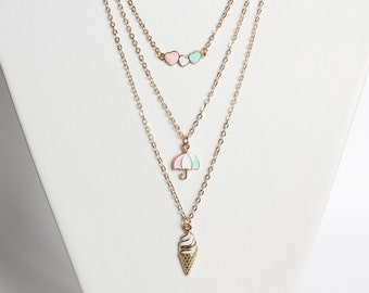 Layered necklace set (pastel blue, pink and white on hearts, umbrella and ice cream pendants)