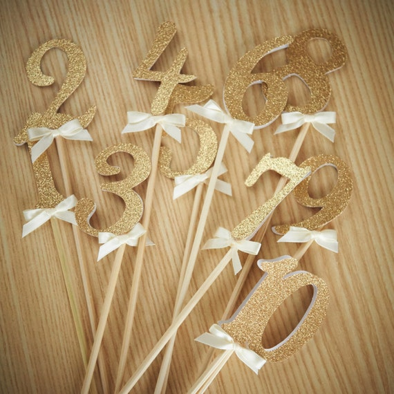 Table numbers on sticks handcrafted in business days