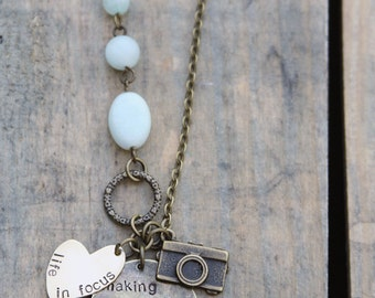 Antique gold photographer design with jade and amazonite stones in the chain