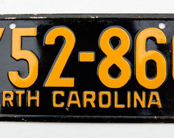Vintage, mid-century, bicycle license plate. North Carolina 1953. Black and yellow.