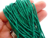 Bright green turquoise matte heshi beads 1.5-2mm 1/2 strand