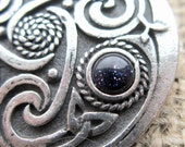 Blue Goldstone Celtic knotwork shield brooch - chunky pewter with triquetras dark blue stone